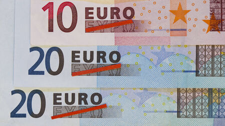 Greek euro crisis depicted by stacked Euro banknotes with crossed out Greek characters for Euro
