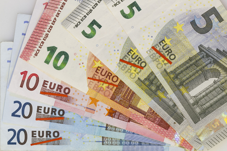 eurozone: Grexit, Greece exiting the Euro, visualized by a wave of Euro banknotes with crossed out Greek characters