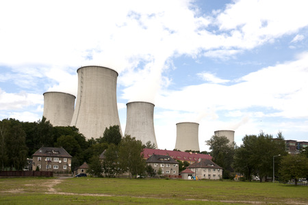 Houses are located right in front of cooling towers of lignite power plants in Bogatynia, Poland Editorial