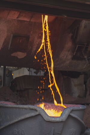 Liquid molten copper poured into smelter bucket at smelter in Copperbelt, Zambia Stock Photo