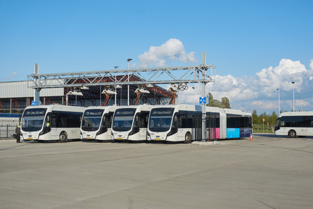 Electric buses charging energy at Schiphol Airport, the Netherlands, as part of sustainable public transport program