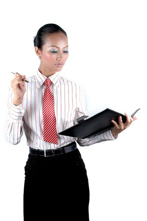 Elegant Chinese businesswoman holding pen and notebook, serious looks, business meeting. photo
