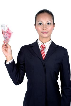 Chinese businesswoman wearing black suit, red tie, elegant looks, kind face expression, holding Chinese RMB banknotes. Stock Photo