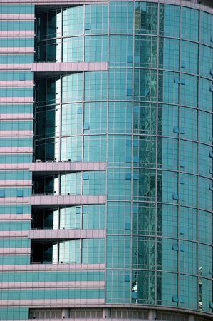 China, modern Chinese skyscrapers close photos - visable windows, glass panels, reflections, walls. photo