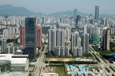 prosperous: China, Guangdong province, modern, prosperous Shenzhen city. General, aerial view from high building. New office skyscrapers, shops and hotels in Futian district.