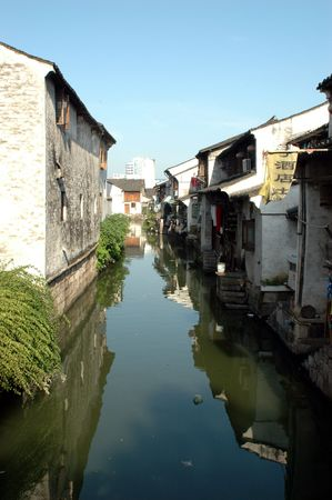 Ancient water town in China, Zhejiang province - Shaoxing. Old wooden houses, small alley, traditional decorations, town connected with water canals.