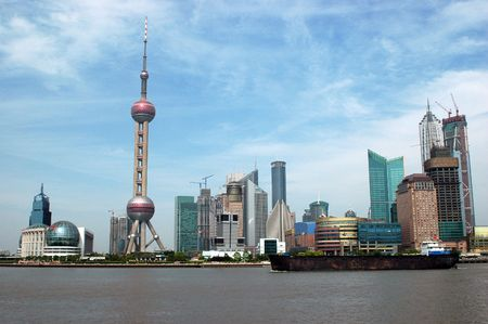 Most famous Chinese city - Shanghai. General view from WaiTang, city scenery with recognizable skyscrapers and TV tower at Huangpu River.