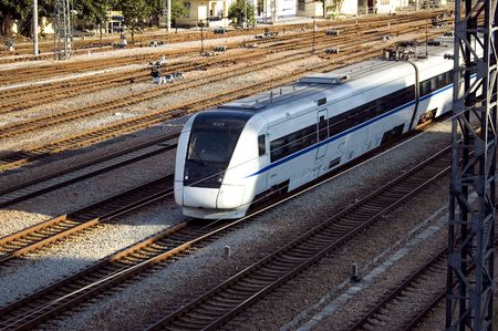 Chinese railway. Fast train connecting Canton and Shenzhen city near Hongkong border.