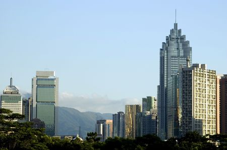 China, Shenzhen city in Guangdong province. City center with modern skyscraper, far behind hills and border with Hongkong.