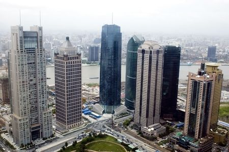 Aerial view of Shanghai city, general cityscape with modern skyscrapers in Pudong and Huangpu River. Stock Photo