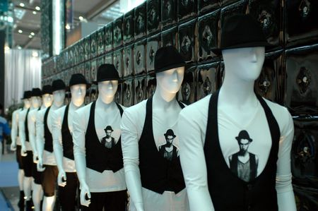Chinese fashion exhibition in Shenzhen city. Dummies standing in one line, wearing same clothes. 版權商用圖片
