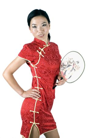 Asian girl in traditional Chinese dress called QiPao, holding simple fan. Stock Photo - 3512092