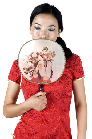 Chinese female model, closing her eyes and covering face with fan. photo