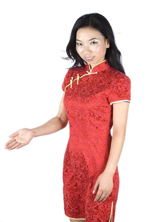 Chinese girl in kind pose, welcoming guests or visitors with her hand gesture. photo