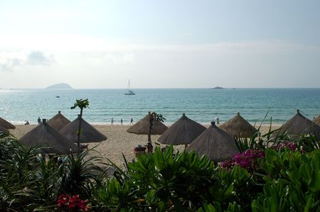China, Hainan island with famous holiday resort Sanya. Beautiful sea side with wide and clean beach. Stock Photo