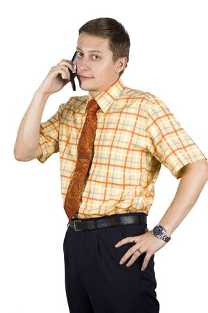 Young, elegant European businessman, wearing suit, shirt and tie. Smiling friendly. Talking on mobile phone Stock Photo - 3671961