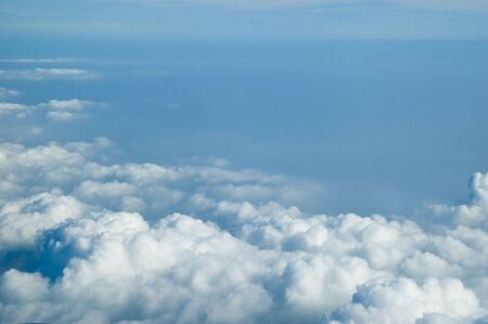 Aerial photo, showing beautiful skyscape. Blue sky covered with differnet clouds.