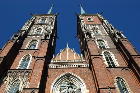 Poland, Wroclaw - old town with most famous and biggest cathedral. Front side with two amazing towers in gothic style. photo