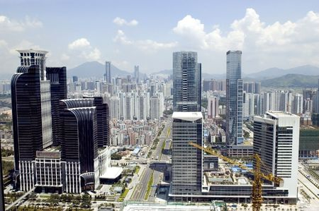 Modern metropolis general cityscape, aerial view with modern skyscrapers, hotels, office buildings, residential areas and roads. Shenzhen city, Guangdong province, China. Stock Photo