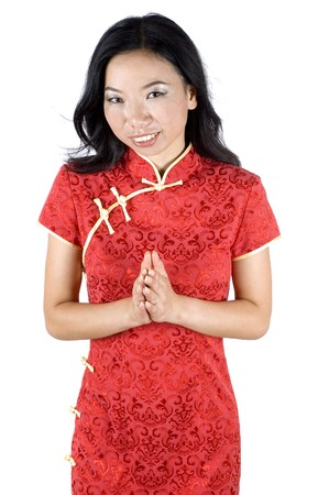 Beautiful Chinese girl sending best wishes for Chinese New Year, model wearing traditional Chinese dress - QiPao.