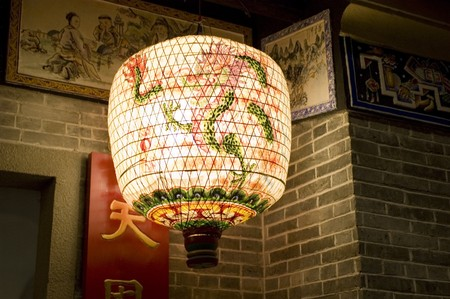 Hongkong - traditional Chinese decoration for New Years celebration. Colorful lanterns decorated with wishes and dragons. Stock Photo