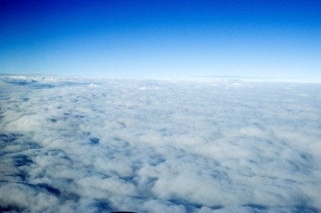 layers levels: Skyscape somewhere above China, photo taken in flight. Clouds holding in one level, showing perfect horizon. Stock Photo