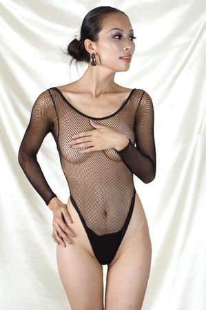 y Asian girl in bodystocking, erotic photo session with beautiful girl, good shape, kind face expression. Gently covered nudity.