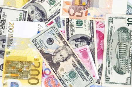 Photo of different banknotes, money in different shapes and colors. Useful for financial, economic backgrounds. photo