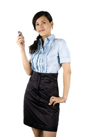 Chinese office lady, elegant clerk. Young Asian girl with kind face expression. Girl holding mobile phone, talking on phone. Stock Photo - 5163244