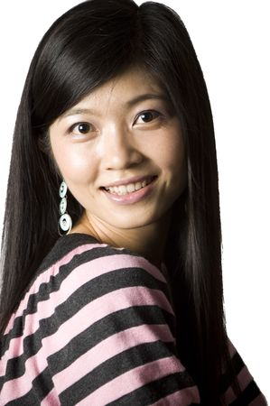Smiling Chinese girl - portrait. Young, pretty Asian model with kind face expression and charming eyes. photo