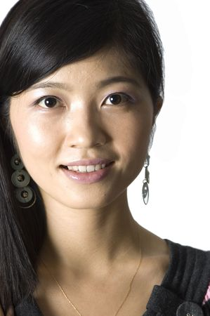 kind: Smiling Chinese girl - portrait. Young, pretty Asian model with kind face expression and charming eyes.