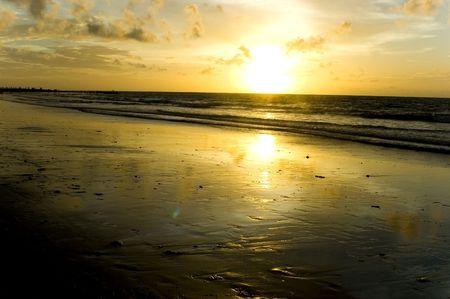 Sunset in Jimbaran beach, Bali Island, Indonesia. Calm, peaceful sunset at Indian Ocean. photo