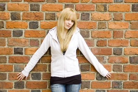 Young, pretty and kind teenage girl in Poland. Schoolgirl with casual clothes, blonde hairs. Peaceful and calm face expression. Stock Photo - 5433335