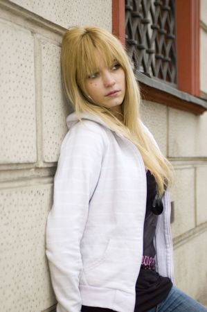 Young, pretty and kind teenage girl in Poland. Schoolgirl with casual clothes, blonde hairs. Peaceful and calm face expression. Stock Photo - 5433330