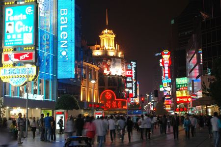CHINA, SHANGHAI, NANJING ROAD - MAY 12, 2007: shopping paradise in China, famous Nanjing Lu with thousands of shops, neon lights, crowd of people. Stock Photo - 6891052