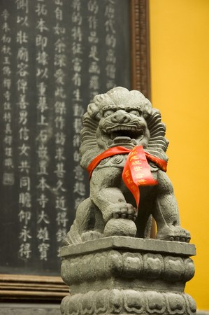 jade buddha temple: Jade buddha temple in Shanghai with small dragon sculpture and Chinese characters.