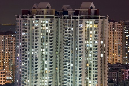 Residential buildings by night, tall skyscrapers in Shenzhen city, China. City with population over 12 millions. Stock Photo - 7618366