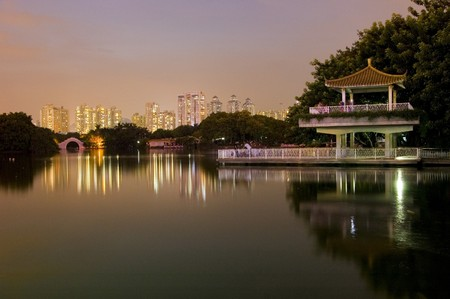 Leeche Park in Shenzhen city by night. Evening landscape with beautiful lake and Chinese pavilion. Stock Photo