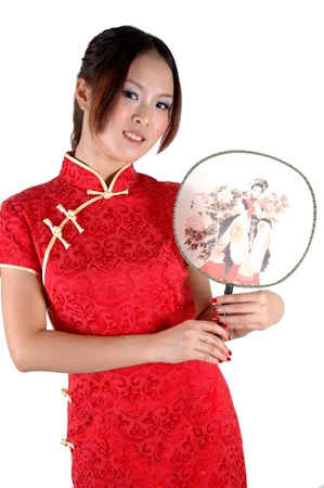 Smiling Chinese girl with fan. Pretty Asian model, wearing traditional dress, smiling. Stock Photo - 8471764