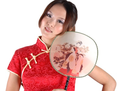 Young Asian model holding fan. Pretty Chinese girl in traditional red dress, close portrait. Stock Photo - 8471752