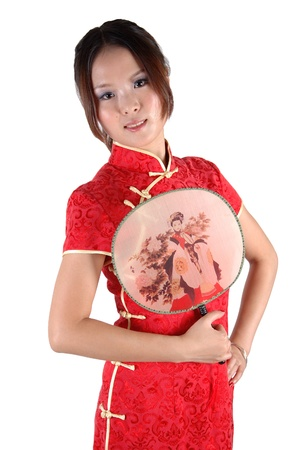 Chinese model in traditional dress called QiPao, holding fan. Asian cute girl, young model with friendly and happy face expression. Stock Photo - 8471748