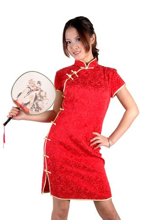 Chinese model in traditional dress called QiPao, holding fan. Asian cute girl, young model with friendly and happy face expression. Stock Photo - 8471751