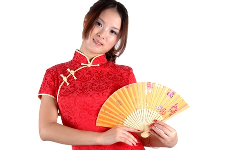 Chinese model in traditional dress called QiPao, holding fan. Asian cute girl, young model with friendly and happy face expression. Stock Photo - 8471740