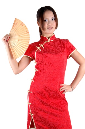 Asian girl wearing traditional red dress, holding fan. Chinese model, kind face expression, good shape. Stock Photo - 8471749