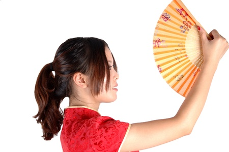 Chinese model in traditional dress called QiPao, holding fan. Asian cute girl, young model with friendly and happy face expression. Stock Photo - 8471750