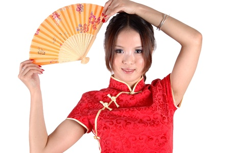 Chinese model in traditional dress called QiPao, holding fan. Asian cute girl, young model with friendly and happy face expression. Stock Photo - 8471758