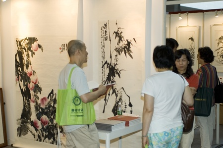 CHINA, GUANGDONG, SHENZHEN - MAY 16, 2009: China International Cultural Industries. Paintings exhibition and art auction. Visitors admire and buy Chinese artworks. Stock Photo - 8465555