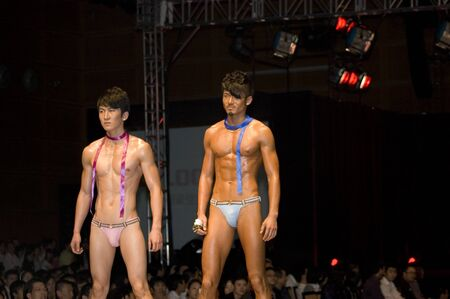 CHINA, SHENZHEN, GUANGDONG PROVINCE - APRIL 5, 2009:  The Fourth Shenzhen International Brand Underwear Fair with fashion show. Female and male models presents underwear and sexy costumes. Stock Photo - 8465563