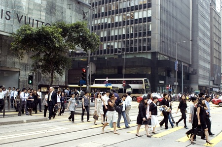 HONG KONG - OCTOBER 29: Lunch break in modern, Chinese city, people going out to restaurants, leaving their office at noon on October 29, 2008 in Hong Kong.