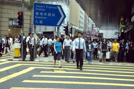 going out: HONG KONG - OCTOBER 10: Lunch break in modern, Chinese city, people going out to restaurants, leaving their office at noon on October 10, 2008 in Hong Kong.